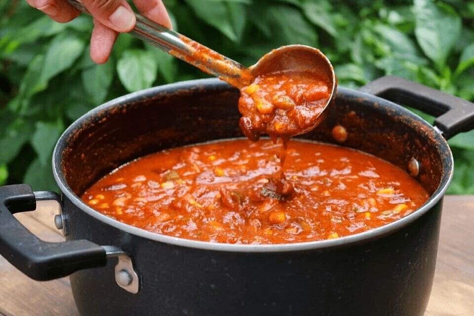 Scooping vegan chili out of the pot