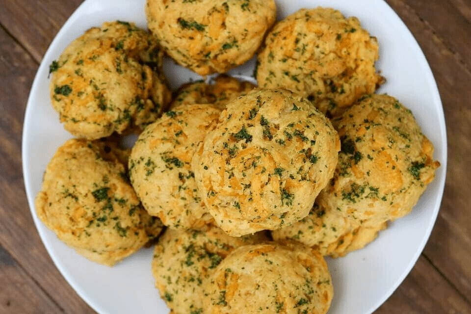 A plate full of vegan cheddar bay biscuits