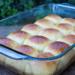 A baking dish full of vegan Hawaiian rolls