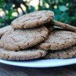 A plate full of vegan ginger molasses cookies