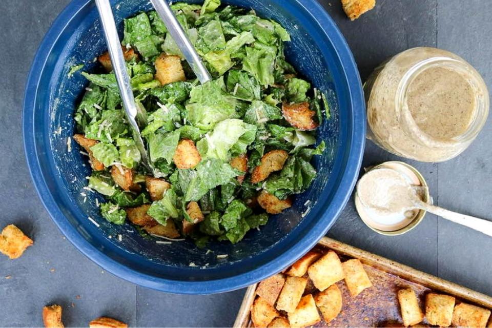 A bowl of Caesar salad with vegan croutons