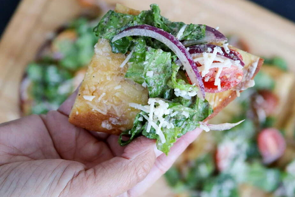 A close up look at a piece of the vegan flatbread pizza