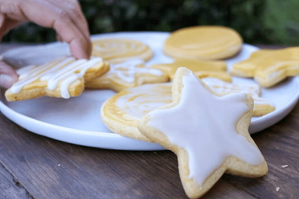 Grabbing a vegan sugar cookie from the plate