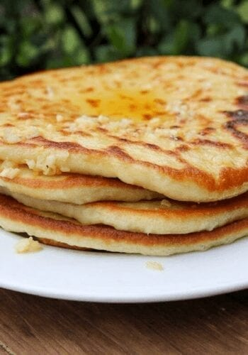 A plate stacked with vegan naan bread