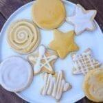 A plate full of mimosa vegan sugar cookies