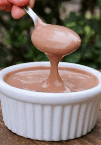 Grabbing a spoonful of healthy vegan pudding
