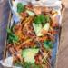 A sheet pan full of Korean-style loaded vegan french fries