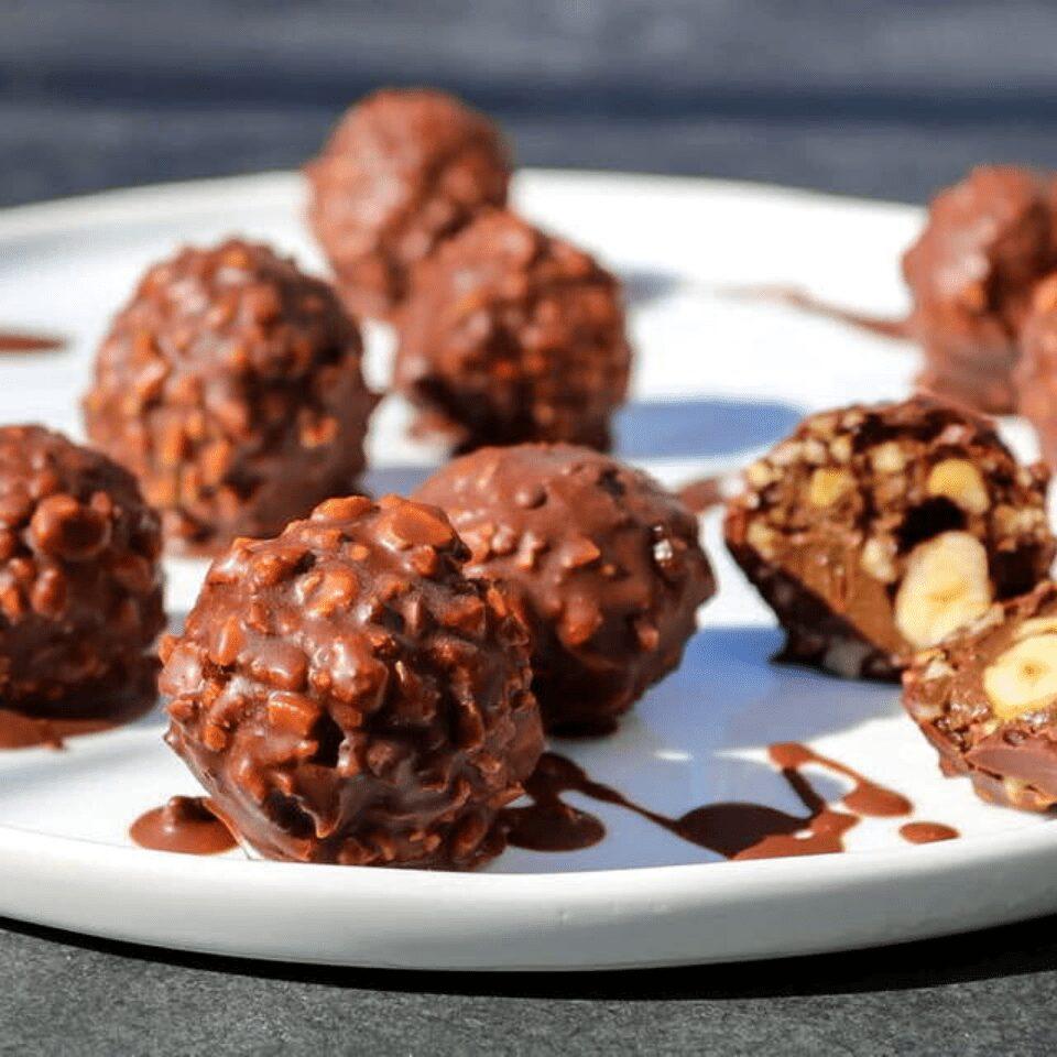 A plate full of vegan Ferrero Rocher truffles