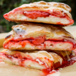 Strawberry and cream cheese vegan danish stacked on top of eachother