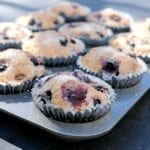 A muffin pan full of vegan blueberry muffins