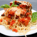 Vegan eggplant parmesan served with spaghetti noodles