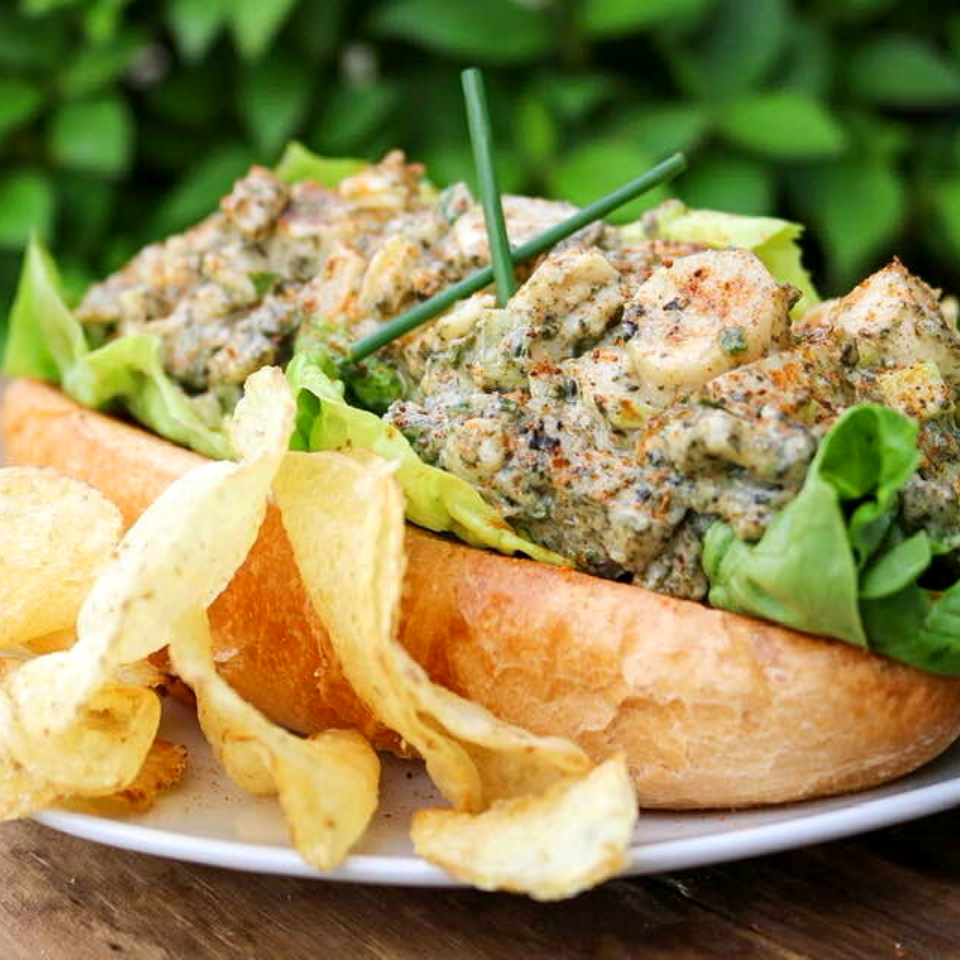 Vegan lobster roll served with kettle potato chips