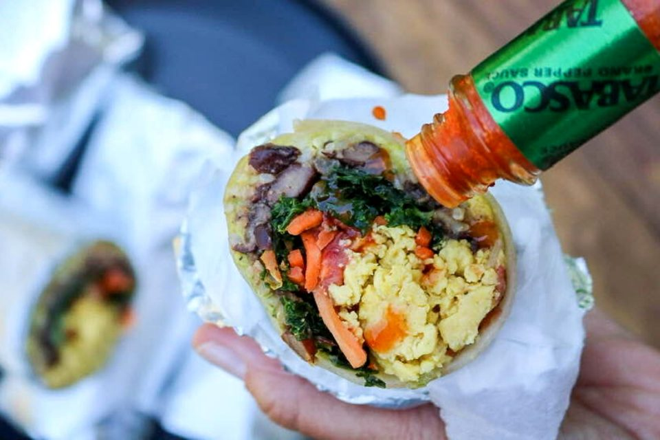 Dabbing hot sauce on a protein packed burrito!