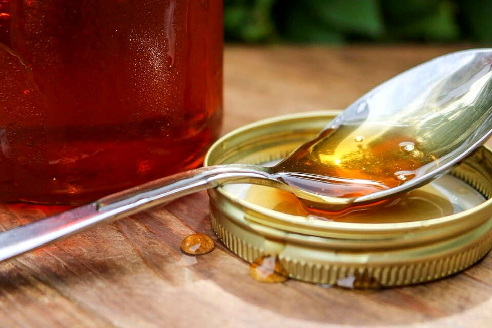 Plant-based honey on a spoon