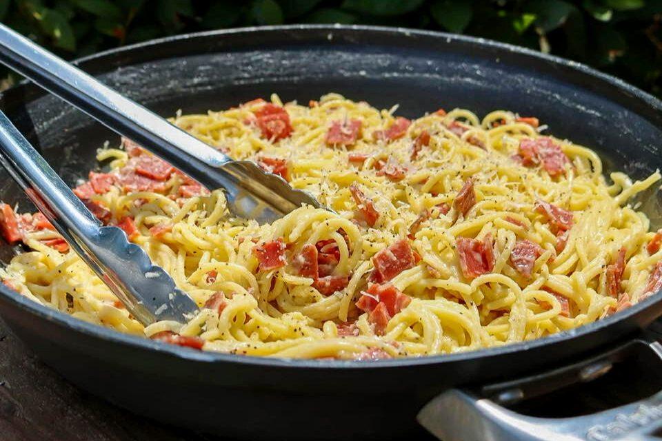 Cream spaghetti carbonara made from vegan pasta, ham, egg, and cheese!