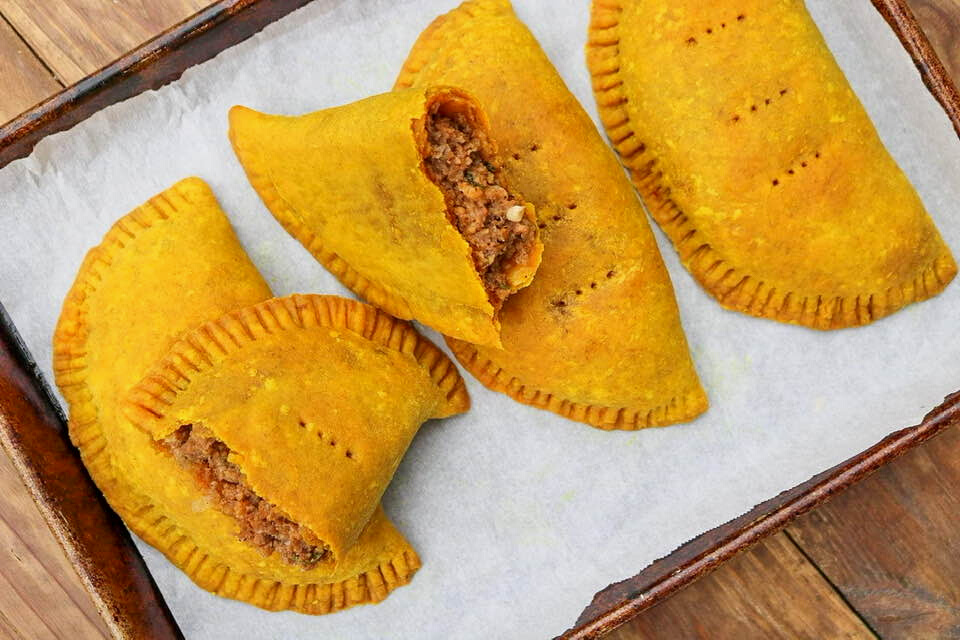 Vegan Jamaican patties on a sheet pan