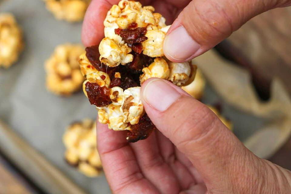 Breaking open a caramel popcorn ball